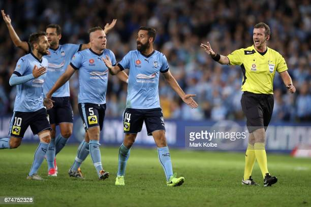Milos Ninkovic Bobo Jordy Buijs and Alex Brosque of Sydney FC argue with the referee Peter Green during the ALeague Semi Final match between Sydney...