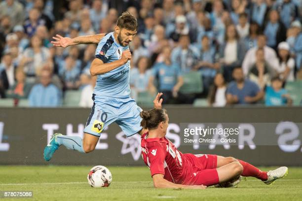 Milos Ninkovic gets past Adelaide's Michael Marrone to shoot and score during the FFA Cup Final match between Sydney FC and Adelaide United at...