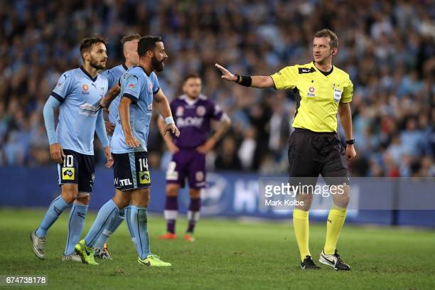 Milos Ninkovic Jordy Buijs and Alex Brosque of Sydney FC argue with the referee Peter Green during the ALeague Semi Final match between Sydney FC and...