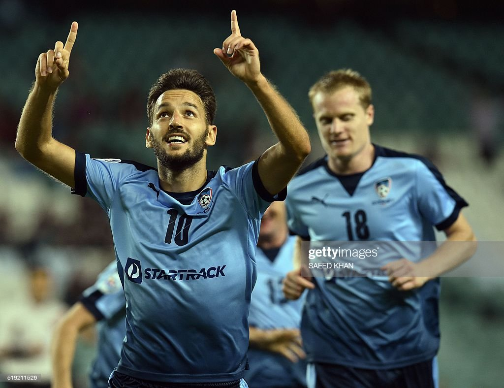 Milos Ninkovic of Australia's Sydney FC (C) celebrates his goal against South Korea's Pohang Steelers in their Asian Champions League football match in Sydney on April 5, 2016. KHAN