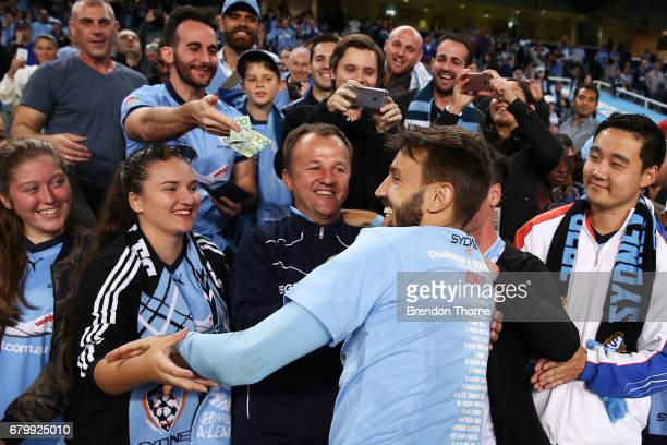 Milos Ninkovic of Sydney celebrates with fans at full time following the 2017 ALeague Grand Final match between Sydney FC and the Melbourne Victory...