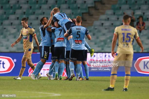 Milos Ninkovic of Sydney celebrates with team mates after scoring a goal during the round seven ALeague match between Sydney FC and Newcastle Jets at...
