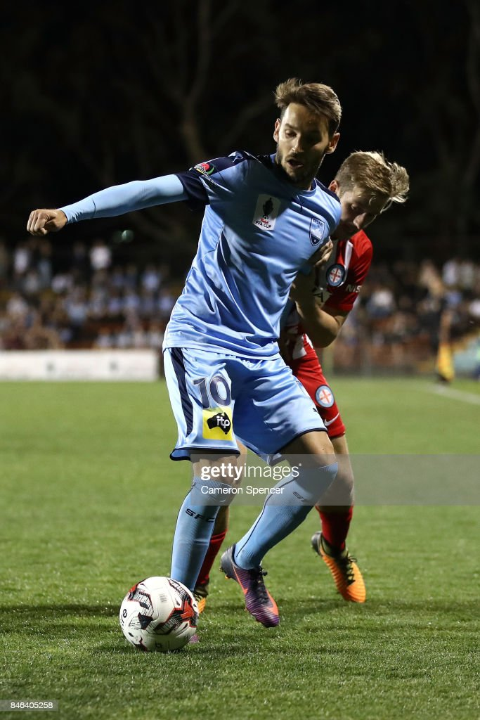 Milos Ninkovic of Sydney FC abd Stefan Mauk of City FC contest the ball during the FFA Cup Quarter Final match between Sydney FC and Melbourne City at Leichhardt Oval on September 13, 2017 in Sydney, Australia.