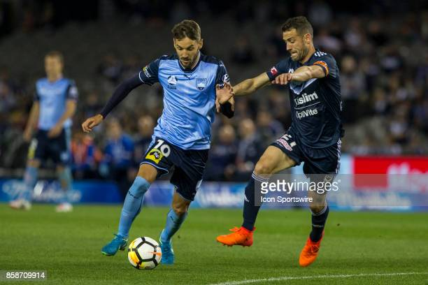 Milos Ninkovic of Sydney FC and Carl Valeri of Melbourne Victory contest the ball during Round 1 of the Hyundai ALeague Series between Sydney FC and...