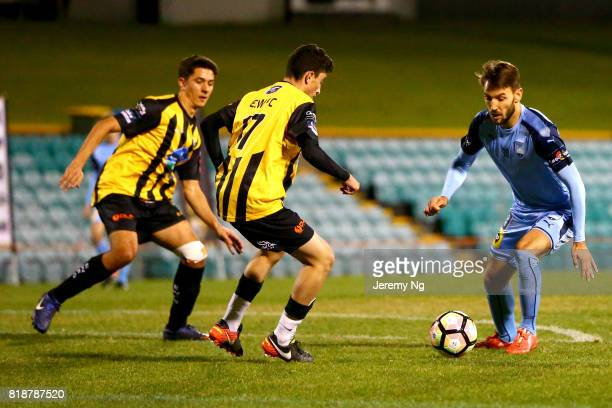 Milos Ninkovic of Sydney FC and Fred Ayoub challenge for the ball during the 2017 Johnny Warren Challenge match between Sydney FC and Earlwood...
