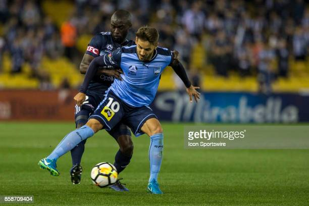 Milos Ninkovic of Sydney FC and Jason Geria of Melbourne Victory contest the ball during Round 1 of the Hyundai ALeague Series between Sydney FC and...