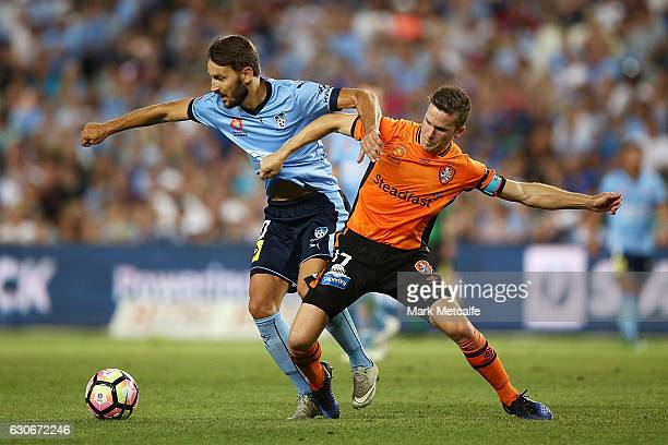 Milos Ninkovic of Sydney FC and Matt Mckay of the Roar compete for the ball during the round 13 ALeague match between Sydney FC and Brisbane Roar at...