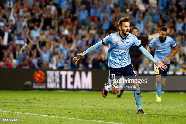 Milos Ninkovic of Sydney FC celebrates after scoring the first goal of the match during the round 27 ALeague match between Sydney FC and the...