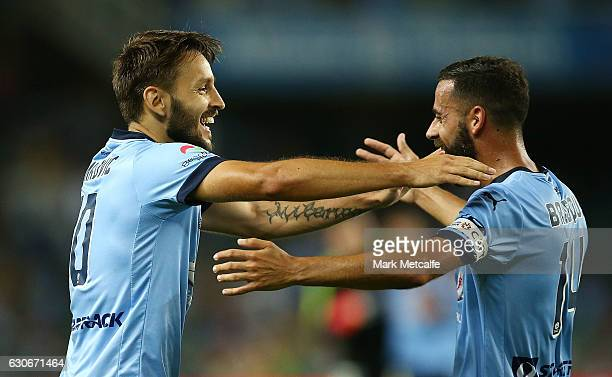 Milos Ninkovic of Sydney FC celebrates scoring a goal with team mate Alex Brosque of Sydney FC during the round 13 ALeague match between Sydney FC...