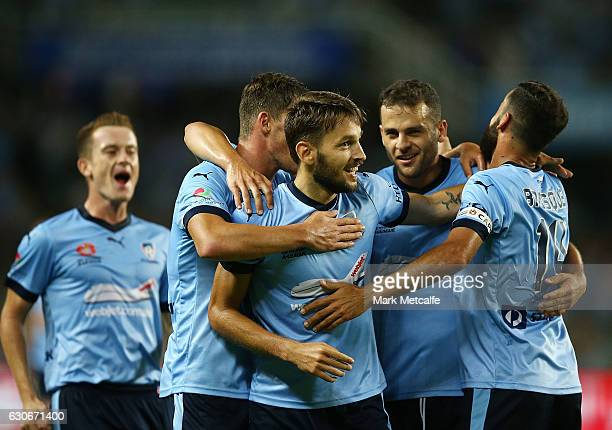 Milos Ninkovic of Sydney FC celebrates scoring a goal with team mates during the round 13 ALeague match between Sydney FC and Brisbane Roar at...