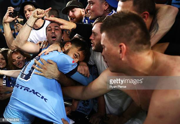 Milos Ninkovic of Sydney FC celebrates with fans after the round one ALeague match between the Western Sydney Wanderers and Sydney FC at ANZ Stadium...