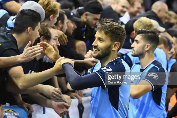 Milos Ninkovic of Sydney FC celebrates with fans after winning the round one ALeague match between the Melbourne Victory and Sydney FC at Etihad...