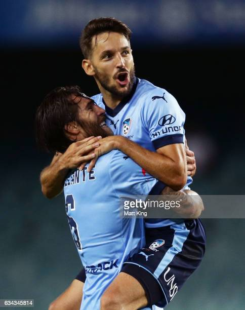 Milos Ninkovic of Sydney FC celebrates with Joshua Brillante after scoring a goal during the round 19 ALeague match between Sydney FC and the...