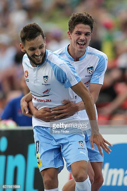 Milos Ninkovic of Sydney FC celebrates with team mate George Blackwood after scoring a goal during the round nine ALeague match between the Newcastle...