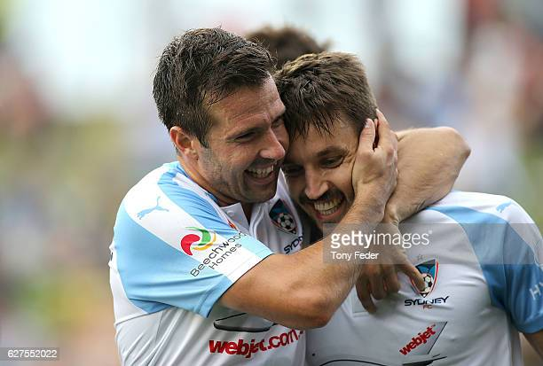 Milos Ninkovic of Sydney FC celebrates with team mates after scoring a goal during the round nine ALeague match between the Newcastle Jets and Sydney...