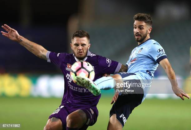 Milos Ninkovic of Sydney FC competes for the ball against Josh Risdon of the Glory during the ALeague Semi Final match between Sydney FC and the...