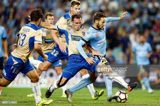 Milos Ninkovic of Sydney FC competes for the the ball with Ben Kantarovski of the Newcastle Jets during the round 27 ALeague match between Sydney FC...
