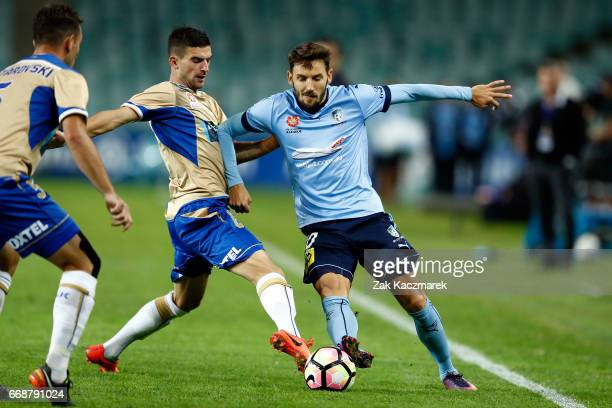 Milos Ninkovic of Sydney FC competes for the the ball with Jason Hoffman of the Newcastle Jets during the round 27 ALeague match between Sydney FC...