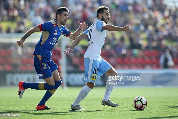 Milos Ninkovic of Sydney FC contests the ball with Jason Hoffman of the Jets during the round nine ALeague match between the Newcastle Jets and...