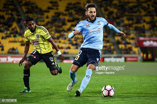 Milos Ninkovic of Sydney FC controls the ball under pressure from Roy Krishna of the Phoenix during the round three ALeague match between the...