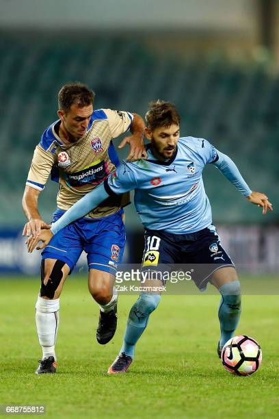 Milos Ninkovic of Sydney FC in action with Ben Kantarovski of the Newcastle Jets during the round 27 ALeague match between Sydney FC and the...