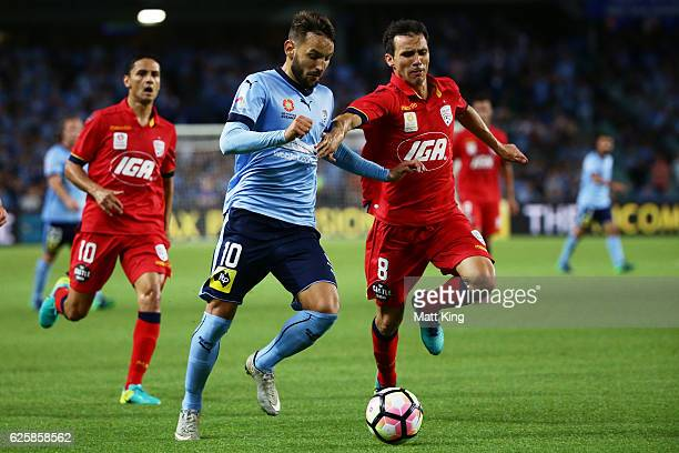 Milos Ninkovic of Sydney FC is challenged by Isaias of United during the round eight ALeague match between Sydney FC and Adelaide United at Allianz...