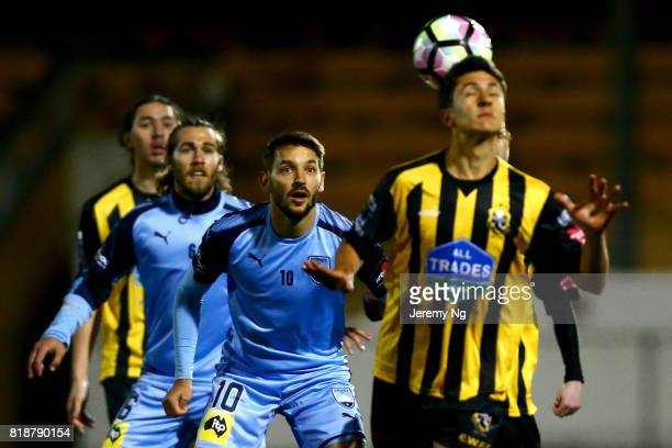 Milos Ninkovic of Sydney FC looks on as an Earlwood player heads the ball during the 2017 Johnny Warren Challenge match between Sydney FC and...