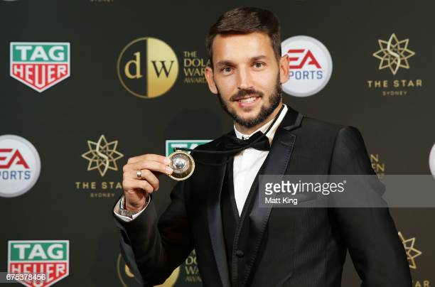 Milos Ninkovic of Sydney FC poses with the Johnny Warren Medal during the FFA Dolan Warren Awards at The Star on May 1 2017 in Sydney Australia
