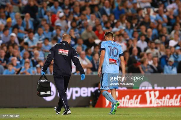 Milos Ninkovic of Sydney leaves the field after sustaining an injury during the FFA Cup Final match between Sydney FC and Adelaide United at Allianz...