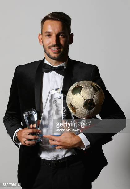 Milos Ninkovic poses with his awards during the 2017 Sky Blue Ball at Sydney Cricket Ground on May 12 2017 in Sydney Australia