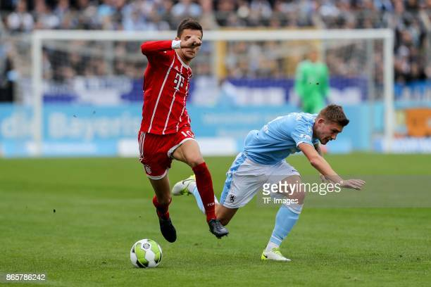 Milos Pantovic of Bayern Muenchen and Nicolas Andermatt of 1860 Muenchen battle for the ball during the match between TSV 1860 Muenchen and Bayern...