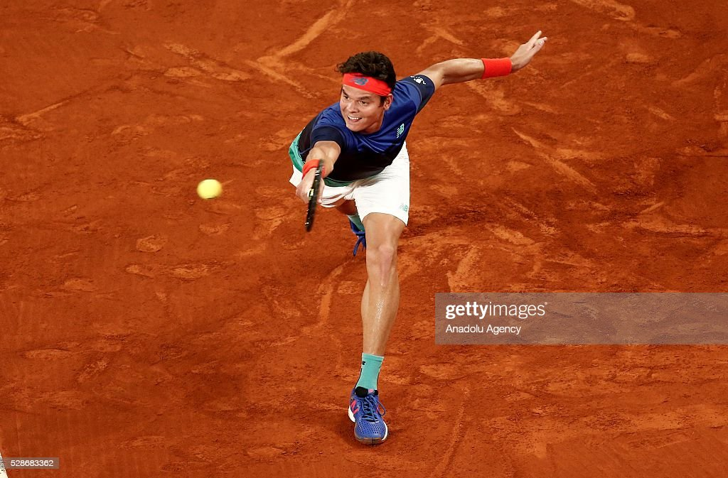 Milos Raonic from Canada returns a ball while playing against Novak Djokovic from Serbia, during a Madrid Open tennis tournament match in Madrid, Spain, on May 6, 2016.