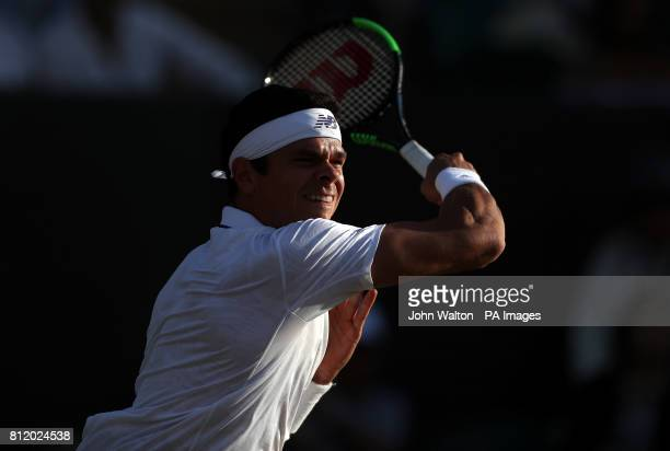 Milos Raonic in action against Alexander Zverev on day seven of the Wimbledon Championships at The All England Lawn Tennis and Croquet Club Wimbledon