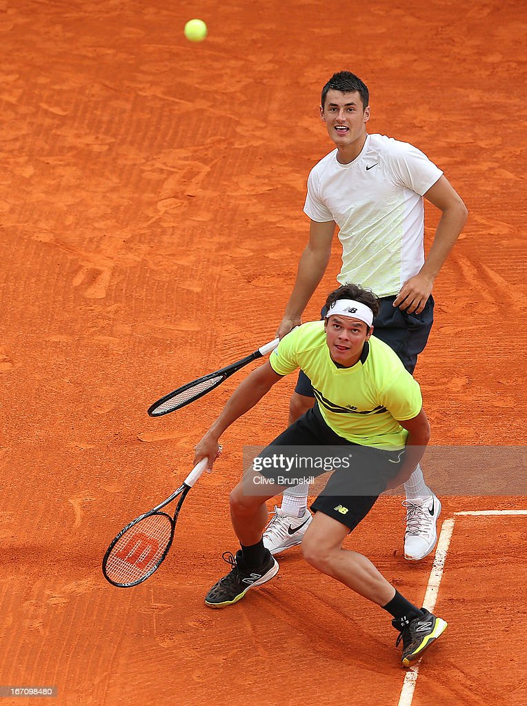 <a gi-track='captionPersonalityLinkClicked' href=/galleries/search?phrase=Milos+Raonic&family=editorial&specificpeople=5421226 ng-click='$event.stopPropagation()'>Milos Raonic</a> of Canada and <a gi-track='captionPersonalityLinkClicked' href=/galleries/search?phrase=Bernard+Tomic&family=editorial&specificpeople=650713 ng-click='$event.stopPropagation()'>Bernard Tomic</a> of Australia in action against Bob Bryan and Mike Bryan of the USA in their doubles semi final match during day seven of the ATP Monte Carlo Masters,at Monte-Carlo Sporting Club on April 20, 2013 in Monte-Carlo, Monaco.