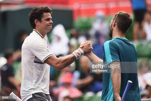 Milos Raonic of Canada and Viktor Troicki of Serbia shake hands after their match during day two of the Rakuten Open at Ariake Coliseum on October 3...
