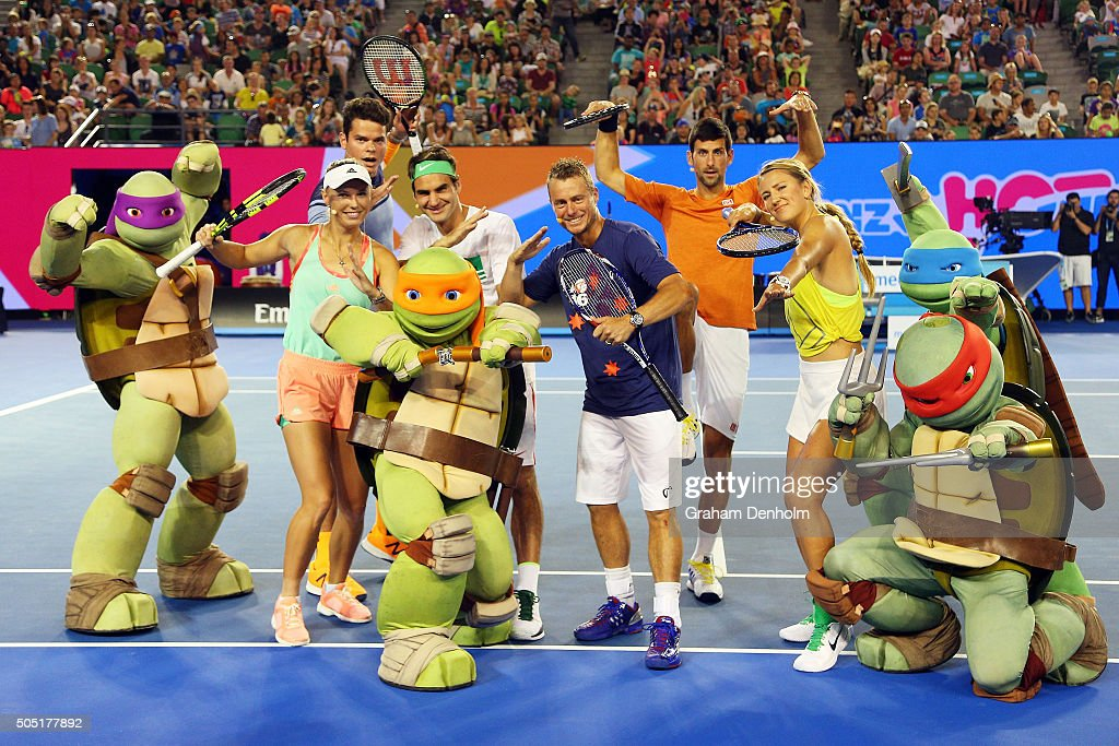 Milos Raonic of Canada, Caroline Wozniacki of Denmark, Roger Federer of Switzerland, Lleyton Hewitt of Australia, Victoria Azarenka of Belarus and Novak Djokovic of Serbia pose with the Teenage Mutant Ninja Turtles following the Rod Laver Arena Spectacular as part of Kids Tennis Day presented by Nickelodeon ahead of the 2016 Australian Open at Melbourne Park on January 16, 2016 in Melbourne, Australia.