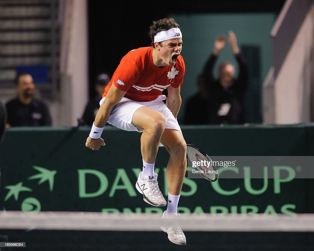 <a gi-track='captionPersonalityLinkClicked' href=/galleries/search?phrase=Milos+Raonic&family=editorial&specificpeople=5421226 ng-click='$event.stopPropagation()'>Milos Raonic</a> of Canada celebrates his victory over Andreas Seppi of Italy during their singles match on day three of the 2013 Davis Cup quarterfinals on April 7, 2013 at Doug Mitchell Thunderbird Sports Centre in Vancouver, British Columbia, Canada.