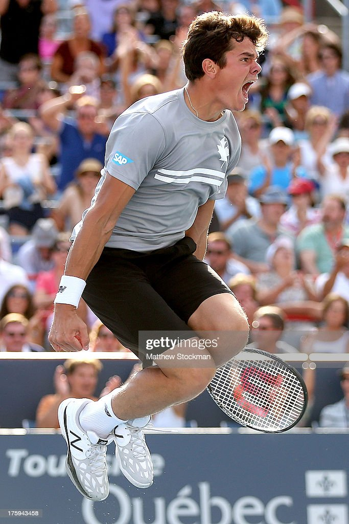 <a gi-track='captionPersonalityLinkClicked' href=/galleries/search?phrase=Milos+Raonic&family=editorial&specificpeople=5421226 ng-click='$event.stopPropagation()'>Milos Raonic</a> of Canada celebrates match point against Vasek Pospisil of Canada during the semifinals of the Rogers Cup at Uniprix Stadium on August 10, 2013 in Montreal, Quebec, Canada.