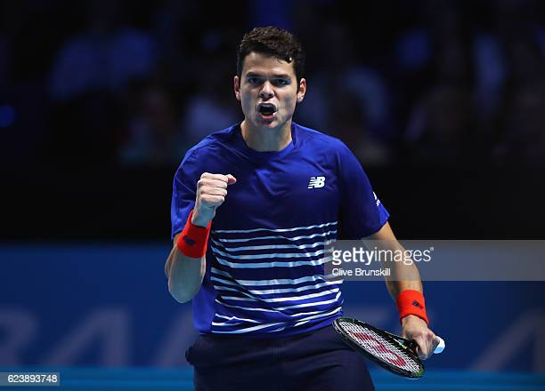 Milos Raonic of Canada celebrates victory in his men's singles match against Dominic Thiem of Austria on day five of the ATP World Tour Finals at O2...