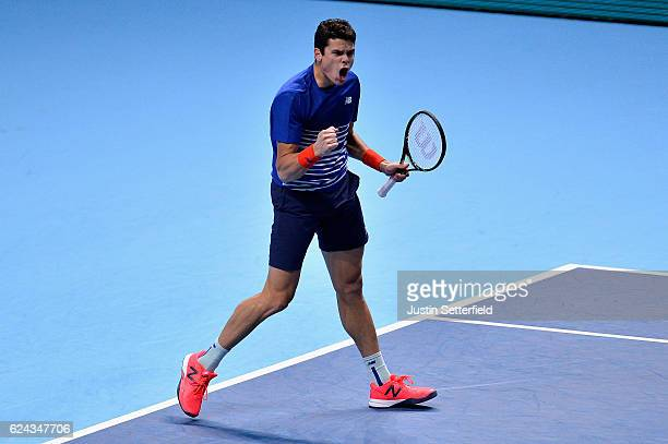 Milos Raonic of Canada celebrates winning the first set during his men's singles semi final against Andy Murray of Great Britain on day seven of the...