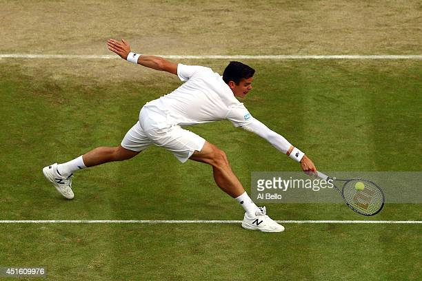Milos Raonic of Canada during his Gentlemen's Singles quarterfinal match against Nick Kyrgios of Australia on day nine of the Wimbledon Lawn Tennis...