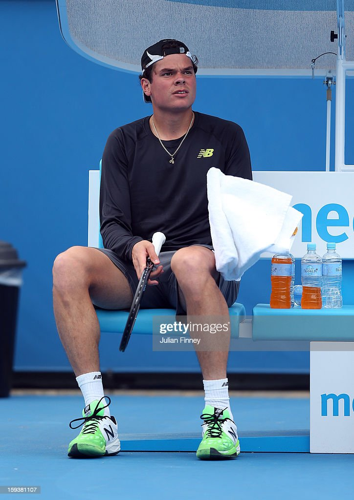 Milos Raonic of Canada has a rest ahead of the 2013 Australian Open at Melbourne Park on January 13, 2013 in Melbourne, Australia.