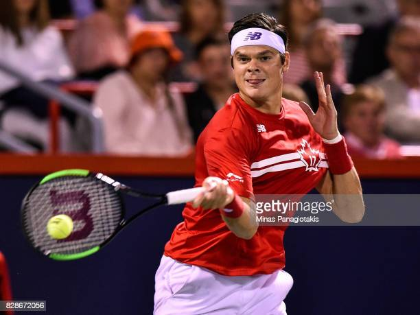 Milos Raonic of Canada hits a return against Adrian Mannarino of France during day six of the Rogers Cup presented by National Bank at Uniprix...