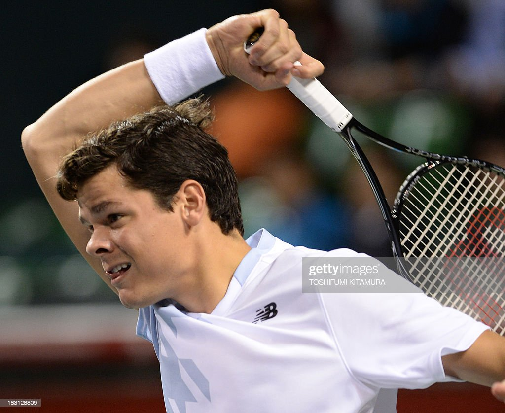Milos Raonic of Canada hits a return against Ivan Dodig of Croatia during their men's singles semi-final match of the Japan Open tennis tournament in Tokyo on October 5, 2013.