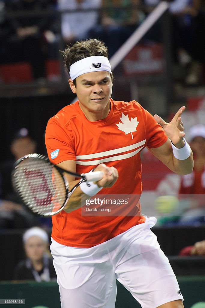 <a gi-track='captionPersonalityLinkClicked' href=/galleries/search?phrase=Milos+Raonic&family=editorial&specificpeople=5421226 ng-click='$event.stopPropagation()'>Milos Raonic</a> of Canada hits a return to Andreas Seppi of Italy during their singles match on day three of the 2013 Davis Cup quarterfinals on April 7, 2013 at Doug Mitchell Thunderbird Sports Centre in Vancouver, British Columbia, Canada.