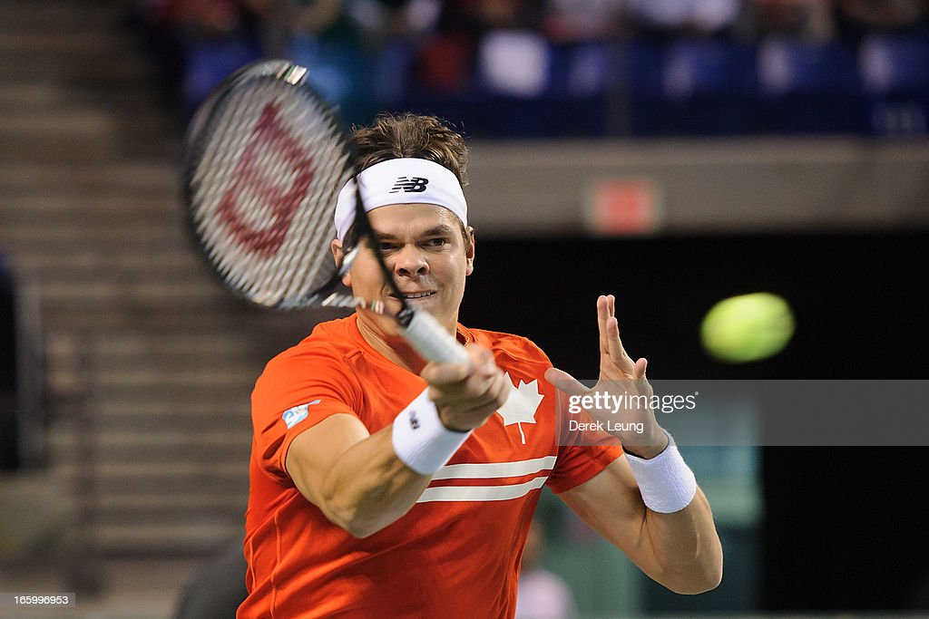 <a gi-track='captionPersonalityLinkClicked' href=/galleries/search?phrase=Milos+Raonic&family=editorial&specificpeople=5421226 ng-click='$event.stopPropagation()'>Milos Raonic</a> of Canada hits a return to Andreas Seppi of Italy during their singles match on day three of the 2013 Davis Cup quarterfinals on April 7, 2013 at Doug Mitchell Thunderbird Sports Centre in Vancouver, British Columbia, Canada. <a gi-track='captionPersonalityLinkClicked' href=/galleries/search?phrase=Milos+Raonic&family=editorial&specificpeople=5421226 ng-click='$event.stopPropagation()'>Milos Raonic</a> defeated Andreas Seppi.