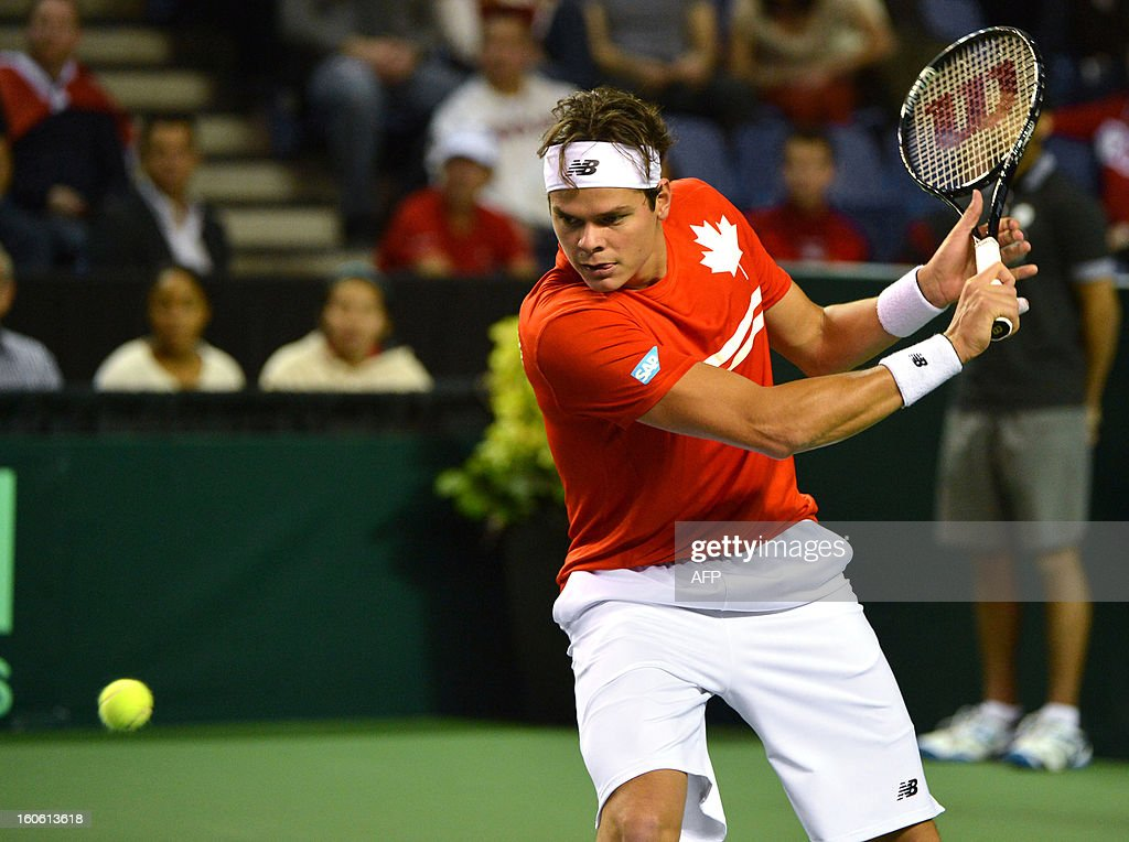 Milos Raonic of Canada hits a return to Guillermo Garcia-Lopez of Spain in a Davis Cup World Group first round match on February 3, 2019 at the Doug Mitchell Thunderbird Sports Centre in Vancouver. Raonic won 6-3, 6-4, 6-2 to send Canada into their first Davis Cup quarter-final. AFP PHOTO/Don MacKinnon
