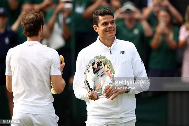 Milos Raonic of Canada holds his trophy following defeat in the Men's Singles Final on day thirteen of the Wimbledon Lawn Tennis Championships at the...