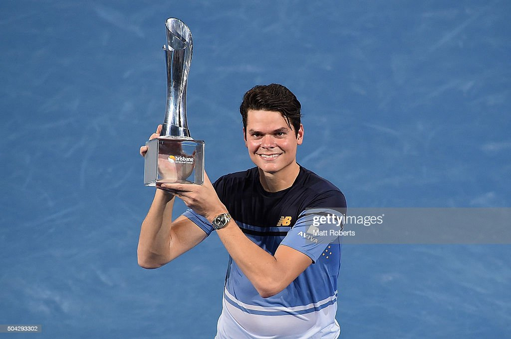 <a gi-track='captionPersonalityLinkClicked' href=/galleries/search?phrase=Milos+Raonic&family=editorial&specificpeople=5421226 ng-click='$event.stopPropagation()'>Milos Raonic</a> of Canada holds the Roy Emerson trophy after winning the Mens Final against <a gi-track='captionPersonalityLinkClicked' href=/galleries/search?phrase=Roger+Federer&family=editorial&specificpeople=157480 ng-click='$event.stopPropagation()'>Roger Federer</a> of Switzerland during day eight of the 2016 Brisbane International at Pat Rafter Arena on January 10, 2016 in Brisbane, Australia.