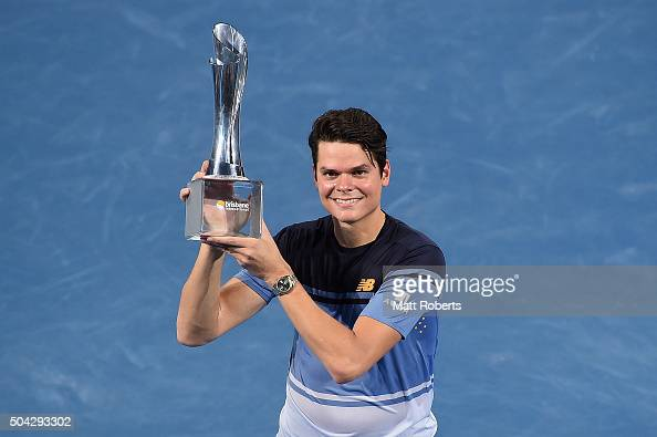 Milos Raonic of Canada holds the Roy Emerson trophy after winning the Mens Final against Roger Federer of Switzerland during day eight of the 2016...